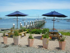 Shaded picnic tables with views of the bay